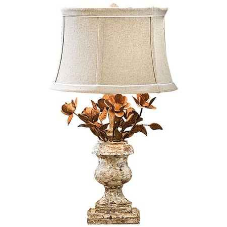 Showcasing an artfully weathered finish the lyon table lamp brings organic appeal and country chic style to your home