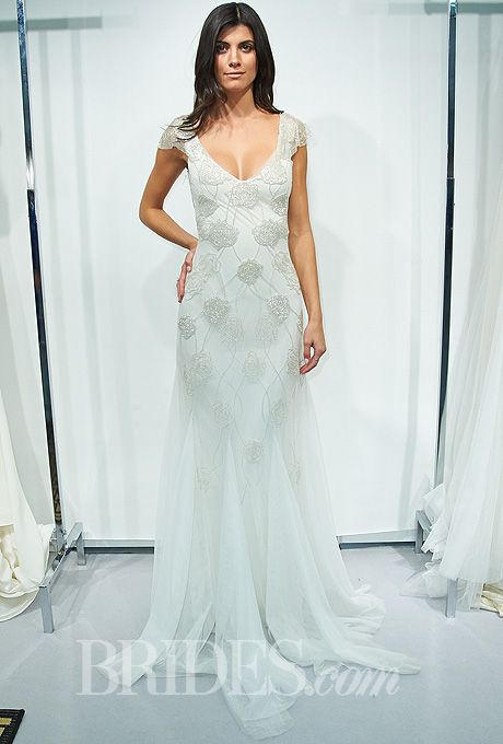 "Brides.com: Sarah Janks - Fall 2014. Style SJ310, ""Dulce"" silk and tulle sheath wedding dress with a scooped v-neckine, short sleeves, and hand-beaded climbing rose details, Sarah Janks"