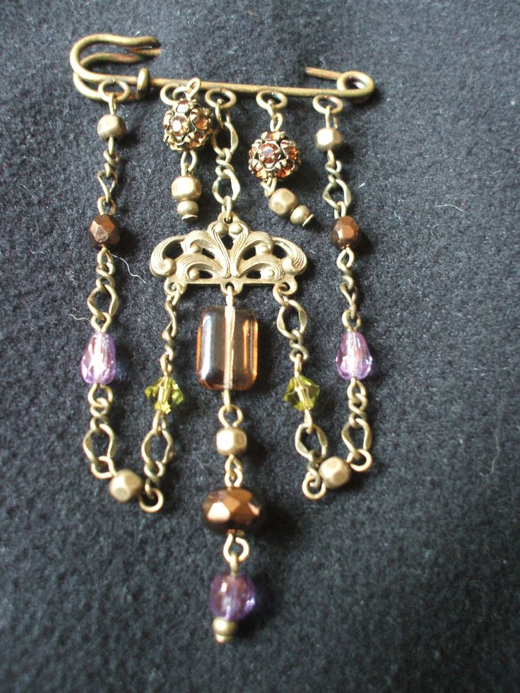 Vintage Kilt Pin Brooch. Antique bronze, using amethyst, green, amber and bronze coloured beads with antique bronze chain and connectors♥