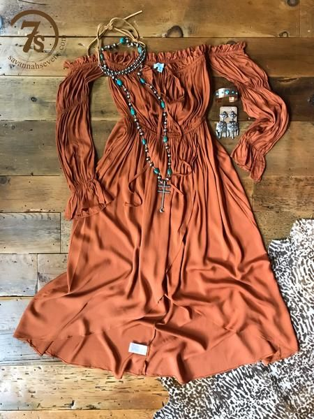 The Keene - Rusty saddle tan retro dress. Gathered stretch off the shoulder, sleeve, cuff and true waist. Peasant style sleeve. Rounded hi-lo hem. Front ties.