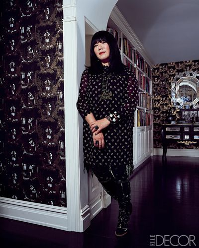 Anna Sui herself, in one of her signature babydoll dresses with tights, boots, and vintage jewelry.