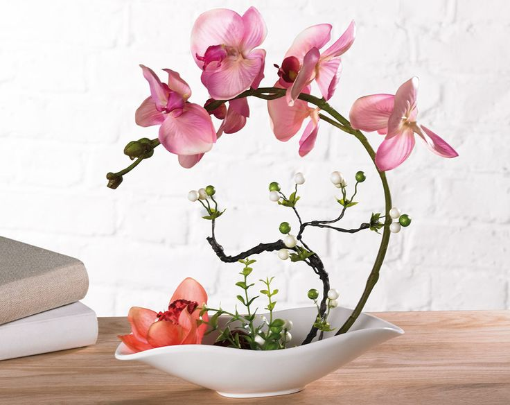 Stunning artificial orchid in ceramic bowl. Adds a touch of nature and feminine charm. Bowl contains pebbles and water-effect gel. Size H24.5 x W27 x D10cm approx.