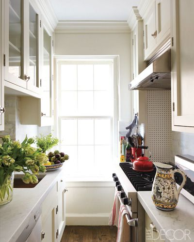 beautiful small space kitchen from the home of photographer Clairborne Swanson Frank; love the counter tops, range & hardware