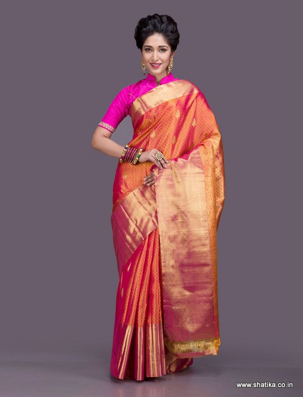 Vibrant and dazzling, this Dharmavaram saree looks like it is basking in the glow of the morning sun. Traditionally woven in the interlocked-weft technique, Dharmavaram sarees comprise of heavy pallus with exclusive designs. Broad borders adorned by brocaded gold patterns made from pure silver zari threads, our Dharmavaram silk sarees online narrate a rich folklore of Andhra Pradesh.