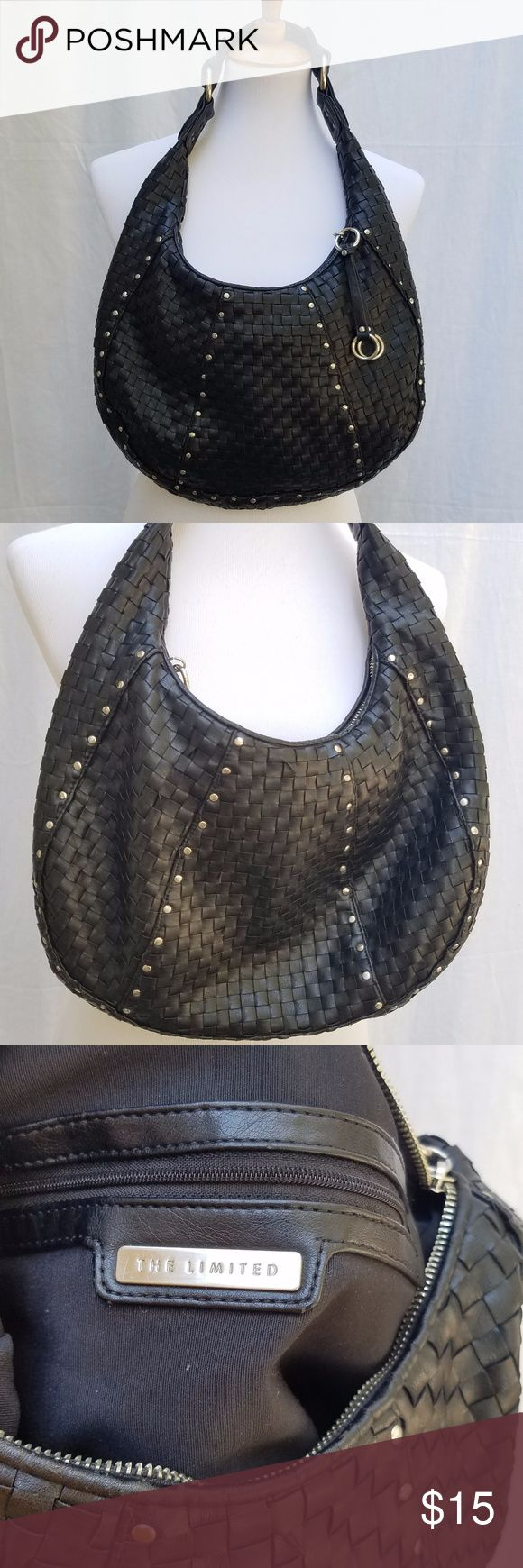 The Limited black Basket weave shoulder bag The Limited black Basket weave shoulder bag, faux leather, brushed silver hardware and studs, very soft feel, slouchy hobo look.  Beautiful bag in great condition, there is minimal wear on the handle as expected.  Bag has a single zipper at the top and a couple of pockets on the inside. The Limited Bags Shoulder Bags