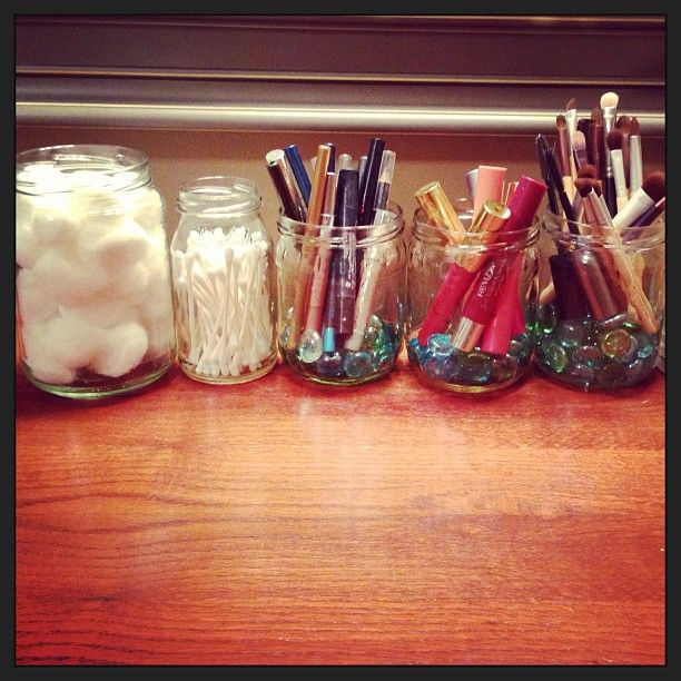 glass jars, recycled into makeup storage
