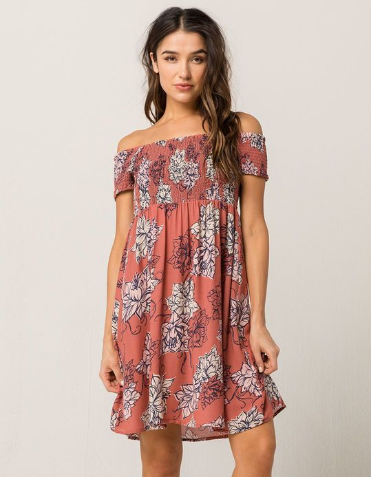 9e0cabf613b69c Soft gauze dress features a smocked bodice and an allover floral print.  Combo style with the optional off the shoulder design. Approx. length:  33.5