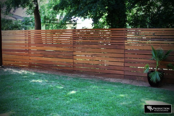 fence idea - I like how the boards get thinner at the top
