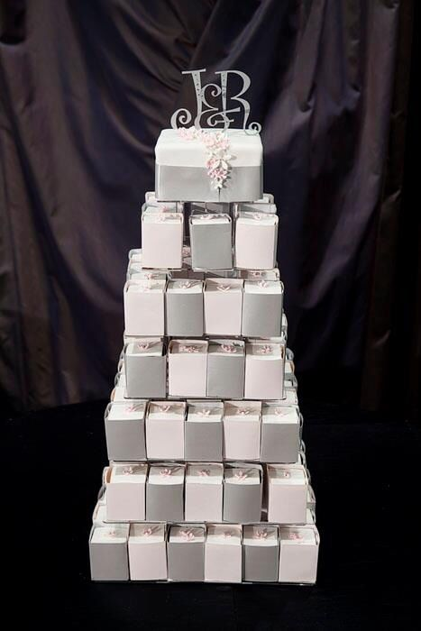 Wedding cake made up of 150 Choc mud and whit Choc mud cakes, wrapped with paper to match the wedding invitations