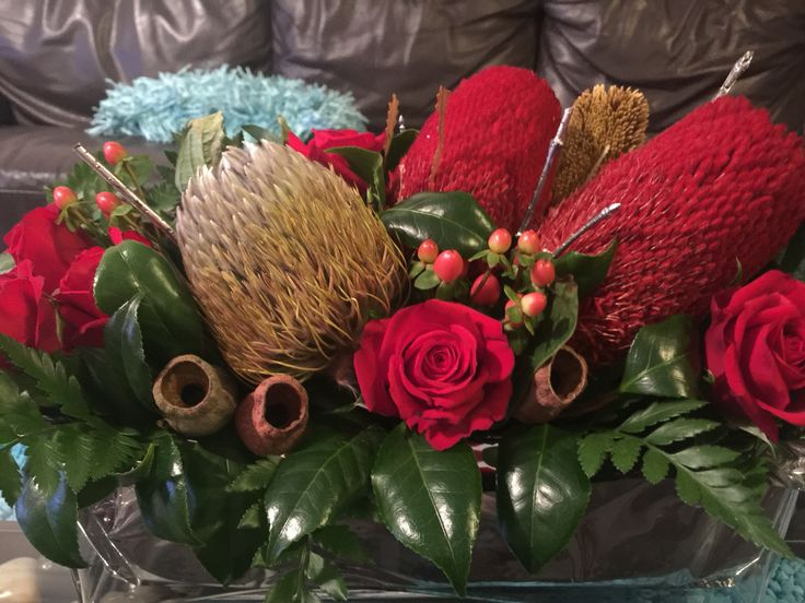 Christmas arrangement with red roses
