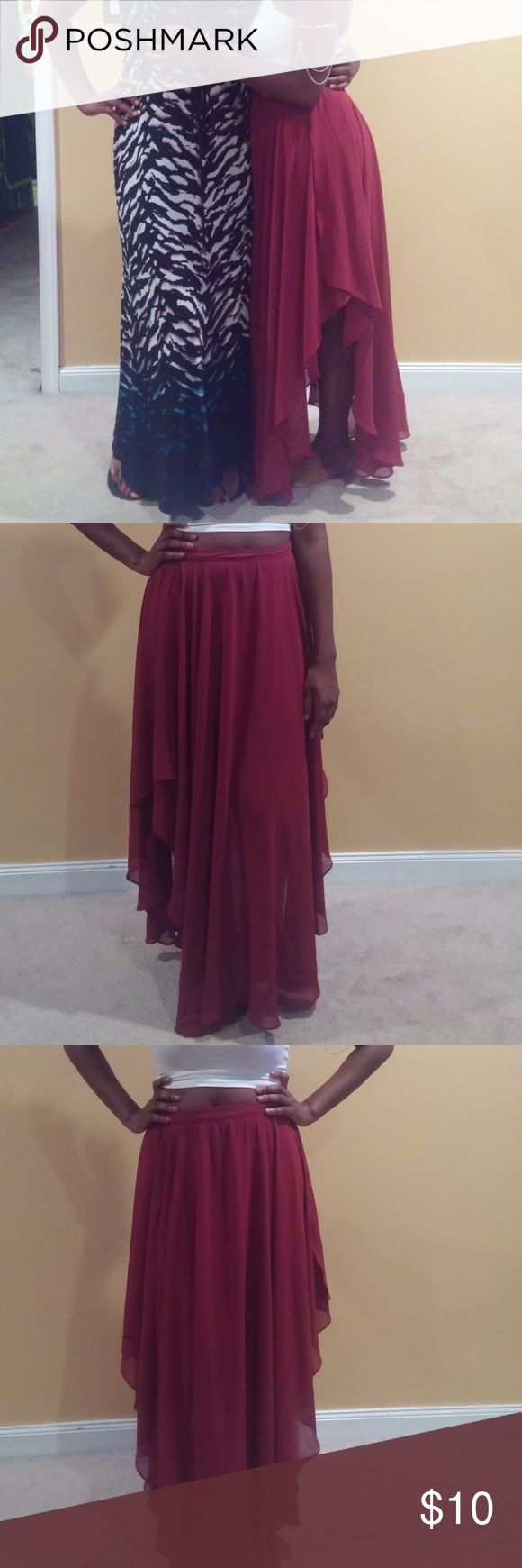 High Low Maxi Skirt Hello, This is a high low maxi skirt. It is a low in the front and back, and high on the sides. I like to wear this skirt in the summer with a crop top and sandals or in the winter with leggingd, boots, crop sweater and leather jacket. This skirt is in great condition. Forever21 Skirts High Low
