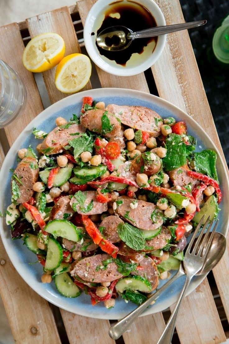 This hearty Greek-style lamb salad is full of wonderfully fresh Greek flavours, and is so quick and easy to prepare. Just simply barbecue the sausages and toss with the salad. Perfect for a summers evening enjoyed with a glass of wine and friends.