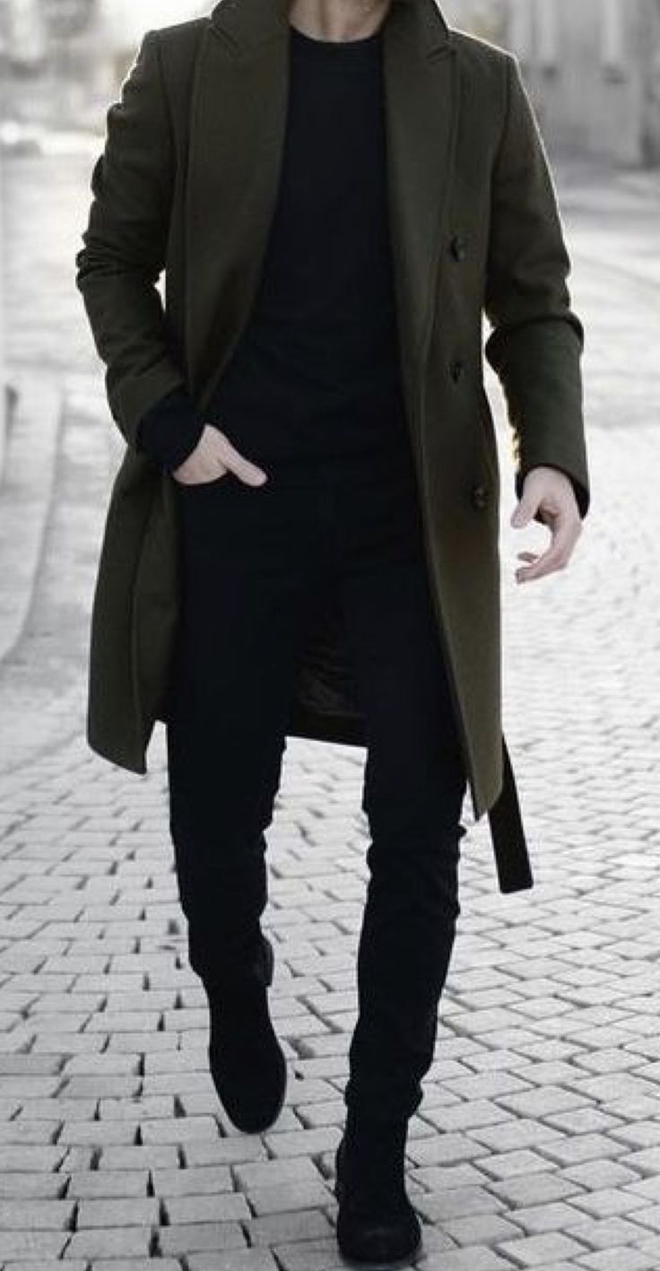 Men's outfit. Black top and pants, green coat