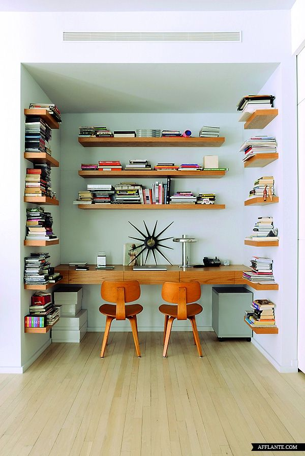 A nook of books: Loft space of artist, Marina Abramovic. Very nice wood shelves/desk in a recessed nook.