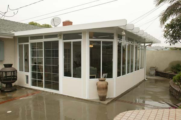 Enclosed patio cost aluminum patio enclosures screened for Porch rooms