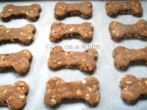 Homemade dog treats with applesauce or bananas, peanut butter, oats, flour, egg