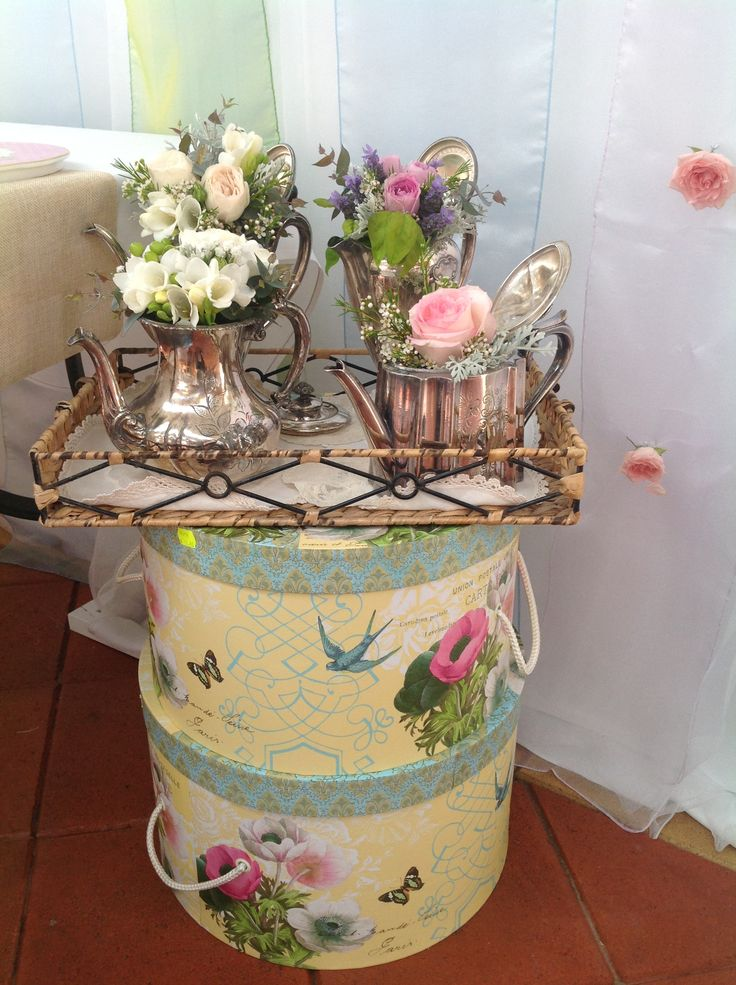 vintage tea pots filled with fresh flowers www.houseofthebride.com.au
