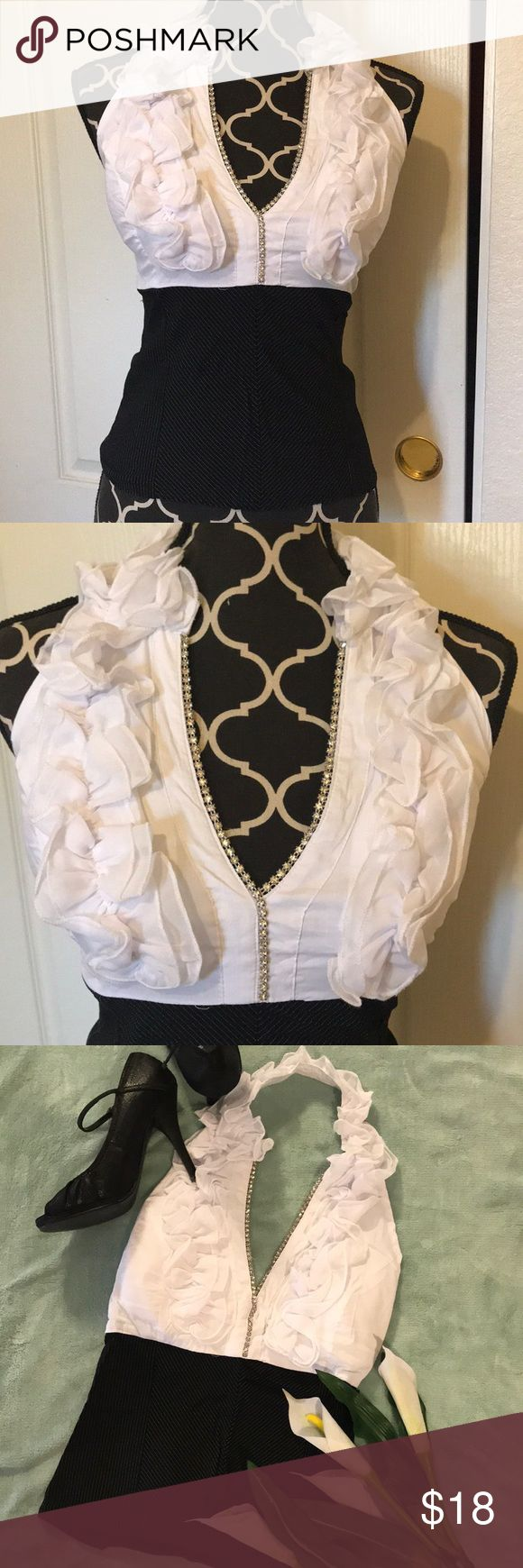 BODY CENTRAL Halter Tops White black halter top with ruffle detail at front through all around the neck. Also Some embellished detail at front, side zipper. Never been worn, been in my closet since I bought it. Body Central Tops