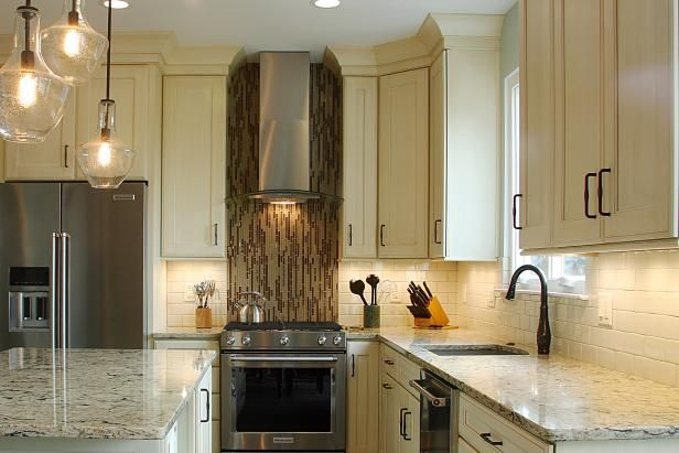 Transitional Kitchen With Eye-Catching Mosaic Tile Oven Backsplash