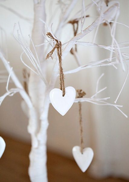 Mo ~ this was in the Christmas Decor but how cool would it be to have at your wedding for  guests to write well wish notes on the hearts? I love it. Tree skirt could be burlap, twine string holds the hearts?