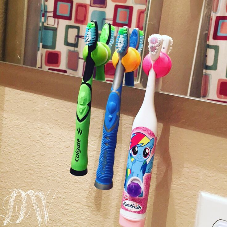 I found the perfect use for our extra cord catchers ($3.99 for 6 at Walmart) and finally the perfect storage solution for kids toothbrushes that are too wide for normal toothbrush storage. Woot! #MommyWin