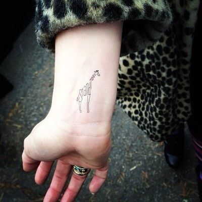 Stand tall giraffe wrist tattoo