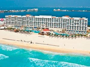 Real Resorts presenta con orgullo la más reciente adición a su división de hoteles: The Royal en Cancún, un hermoso hotel que crea una íntima atmósfera de impecable servicio siguiendo fielmente nuestro principio básico de exceder sus expectativas.    Nunca sacrificando el compromiso con el lujo, el hotel The Royal en Cancún mantiene un agradable ambiente de elegancia casual.