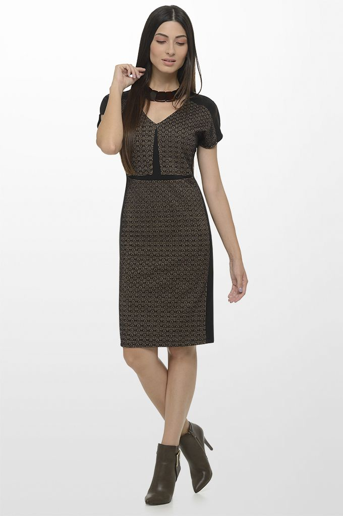 Sarah Lawrence - short sleeve jacquard dress with black trimming, necklace.