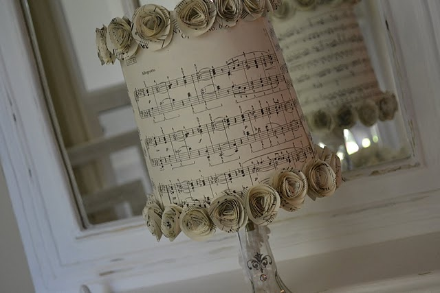 Oh the things you can do with old sheet music!  So cute for the piano room.