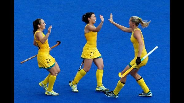 Jodie Schulz 7 of Australia celebrates scoring a penalty with teammates Jade Close 31 and Hope Munro 28 during the second half against China during the Women's Hockey classification match for 5th and 6th place between Australia and China on Day 14 of the London 2012 Olympic Games at the Riverbank Arena Hockey Centre on August 10, 2012 in London, England.