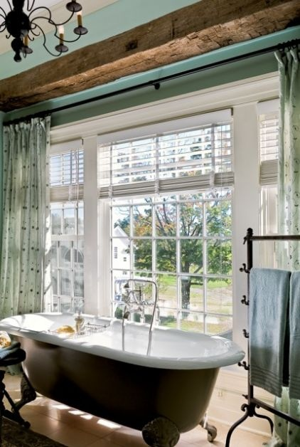 Beautiful tub and windows and I love the beam.