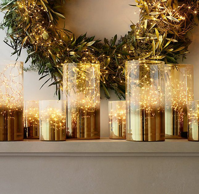 Illuminate your home with a shimmering golden glow when you add fairy lights to these sleek glass hurricanes