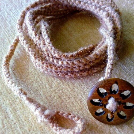 Handmade wrap bracelet with a  beautiful wooden button for closure!...