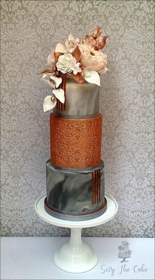 Marble effect and copper lustre wedding cake by Seize The Cake