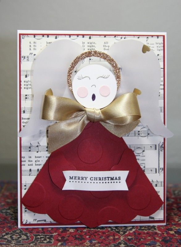 I just love this beautiful singing angel. I used the template Ann provided and decided to make my angel rest on a card.  She is singing a Christmas tune.  I used gold ribbon instead of a paper bow. I cut out two sets of wings in vellum.  I hope you create an angel of your own so we can see your creativity shine.  Thanks for viewing and commenting.