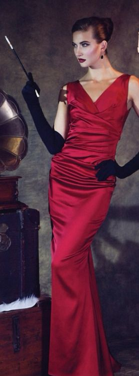 The perfect glamorous red satin gown to be worn with the red satin pumps and evening clutch. The added touch of long black gloves and long cigarette holder exemplify the look of Old Hollywood glamour.