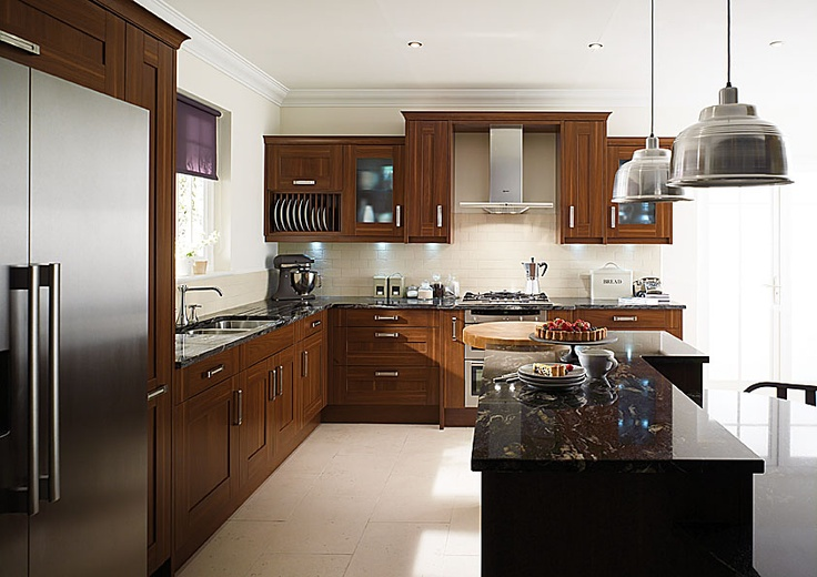 Cherry Cabinets, Light Floors, black cosmic counters, stainless steel appliances.
