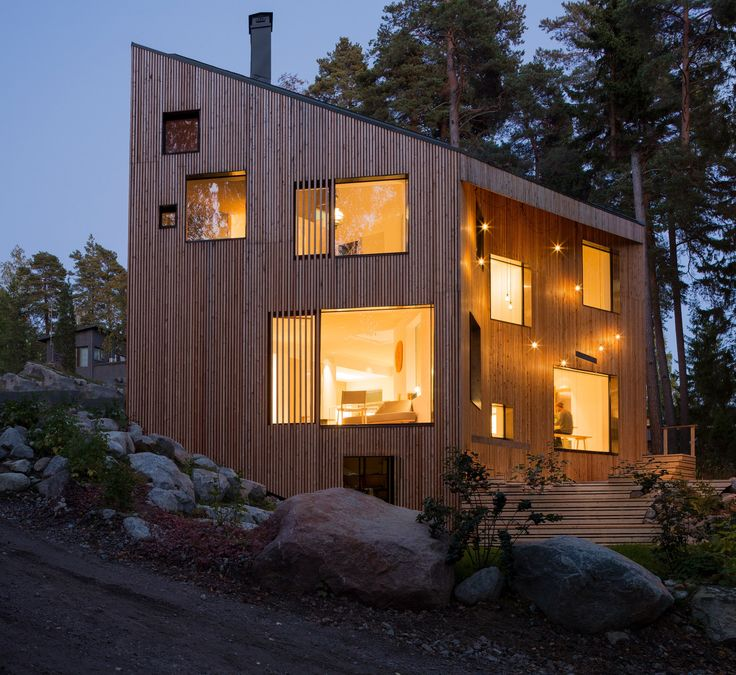 This angular house in a forest near Helsinki is host to a number a child-friendly features including a climbing wall, gymnastic apparatus.