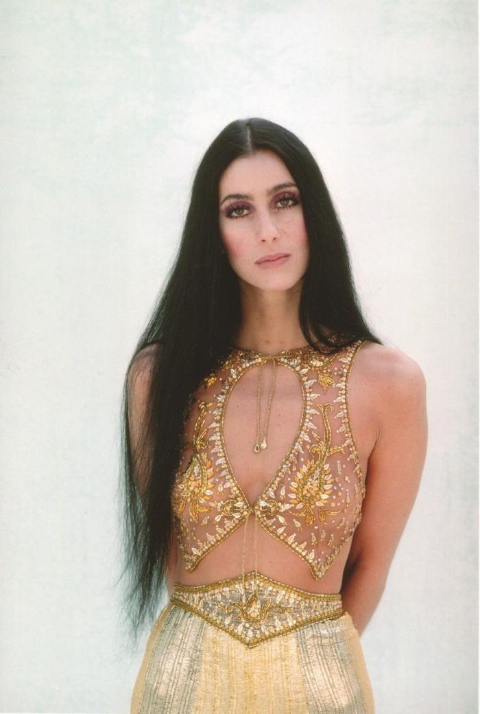 Cher wears her signature long black hairstyle on Strong Enough book cover