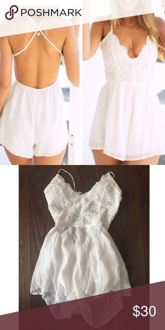 White Lace Playsuit Purchased from another seller who stated this was purchased from Sabo Skirt, there is no tag with the brand, just the M size tag. Worn once. Slight padding in the cups. Sabo Skirt Pants Jumpsuits & Rompers
