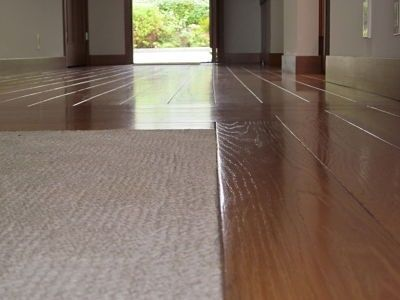 Wood floor with carpet inlay