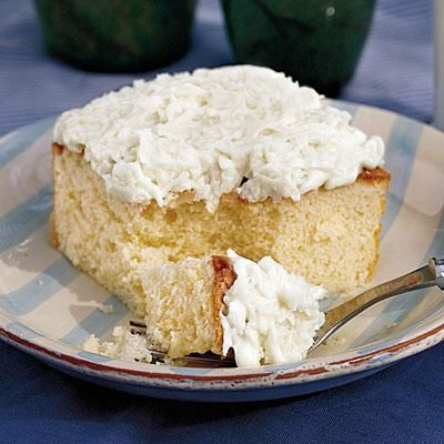 Coconut Sheet Cake | Coconut Sheet Cake, made from a white cake mix, gets an added boost of flavor from homemade Coconut-Cream Cheese Frosting. | #Recipes | SouthernLiving.com