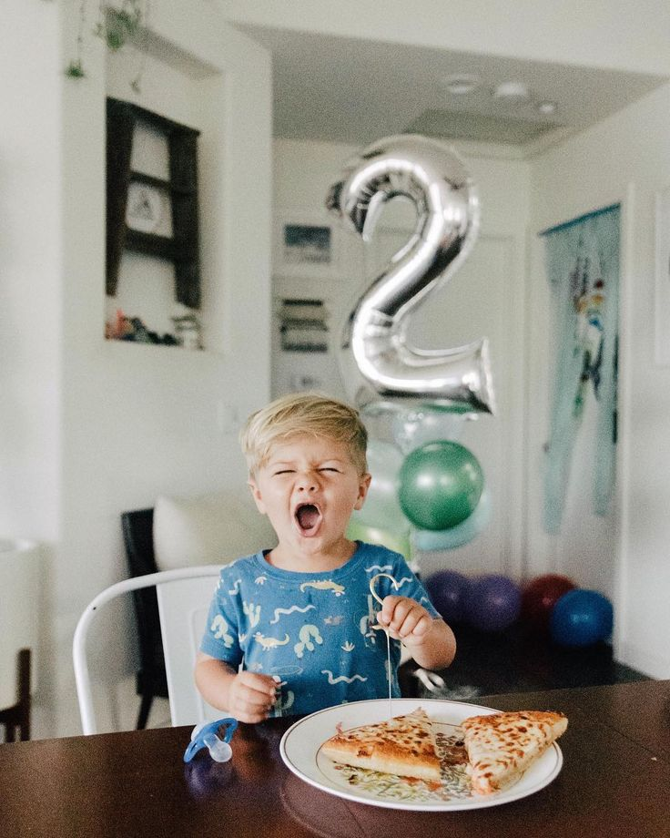 Happy 2nd birthday Ezekiel! This photo is you in so many ways including your love for pizza (which we let you have for breakfast this morning).... but just in case I missed something I wrote you a letter... Ezekiel what a precious gift you are to our family. God knew we needed you and your big open smile tough disposition wild heart and adventurous soul. Zeke you have something special about you from the way you look into people's eyes say hello to everyone to the way you love all the old…