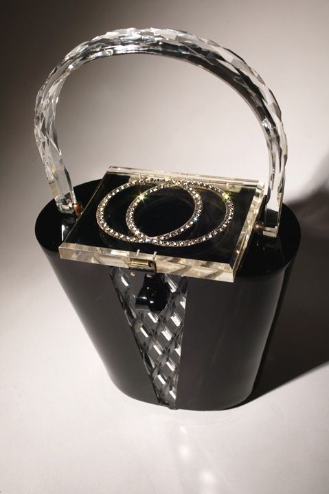 Vintage 1950's Black and White Lucite Handbag. I Remember that we often had scarves in these bags.