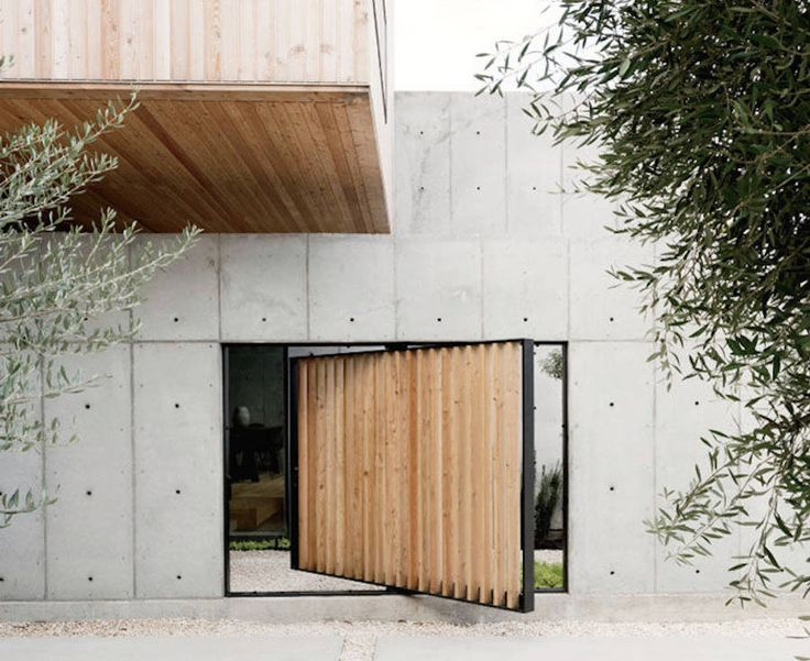 The Concrete Box House  The Concrete Box House is a house built by American architecture practice Robertson Design. The concept of this house comes from the Japanese traditions with its rotating wooden portal. The structure of this residence is composed of 3 boxes : a wooden box and two boxes of different sizes in concrete.  Photos by Jack Thompson.             #xemtvhay
