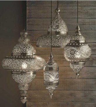 Not sure where to put it but I really like the 3 larger ones. Maybe the open faced one would work over the kitchen island??? Silver Moroccan Hanging Lamp, vivaterra.com