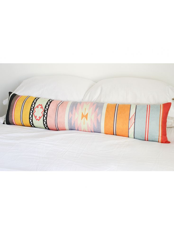 Designer Tip: You don't need tons of different throw pillows on your bed to make it stylish. If you are looking for something dramatic without the fuss, an extra long bed pillow is the perfect solution. We love this brightly colored tribal pillow for a fun touch to your space. Perfect for a laid back, bedroom that needs a pop of color.