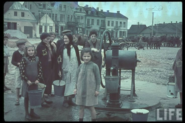 Jewish women and children in Gostynin Poland  after the German invasion.  Location: Gostynin, Poland   Date taken: October 1939.