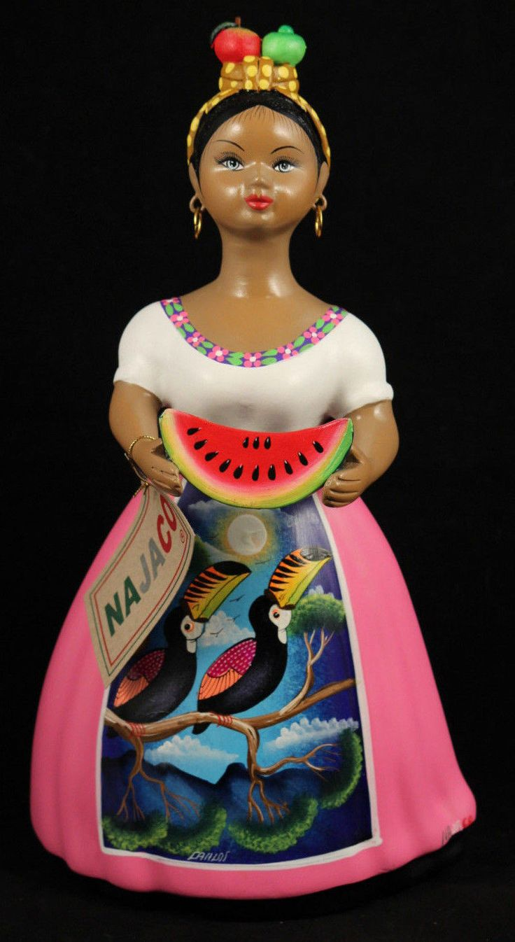 """- """"Lupita"""" with Watermelon, Mexican Ceramic Figurine with a Rose Color Dress. - The figurine is 11-3/8"""" tall and 6 1/4"""" wide at the base. - Please note all details. This figurine has the Dress, Apron"""