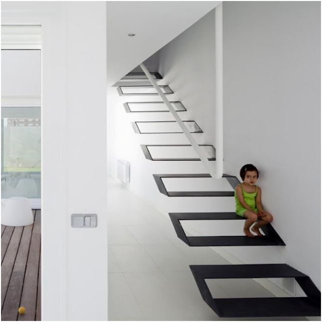 Very original stairway design. Metallic floating staircase